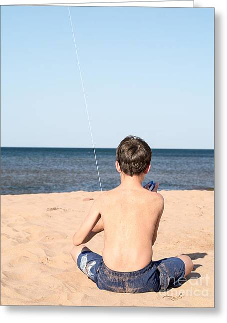 Boy At The Beach Flying A Kite Greeting Card