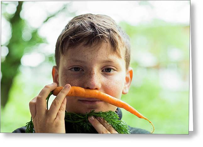 Boy Holding A Carrot On Top Lip Greeting Card by Gombert, Sigrid
