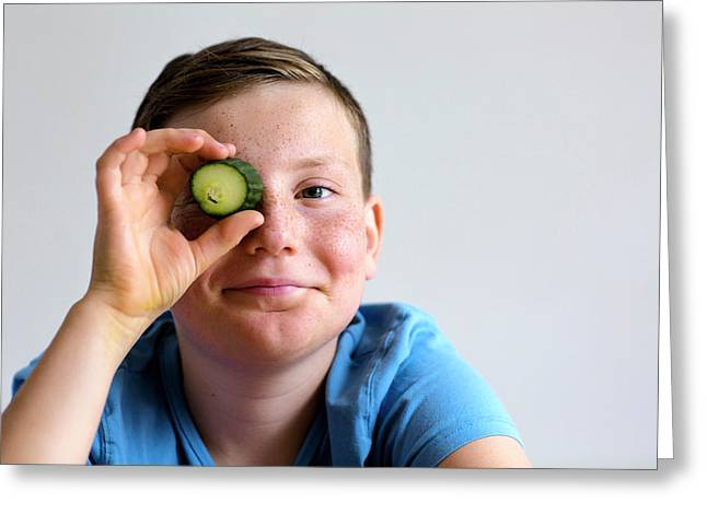 Boy Holding Cucumber Over Eye Greeting Card by Gombert, Sigrid