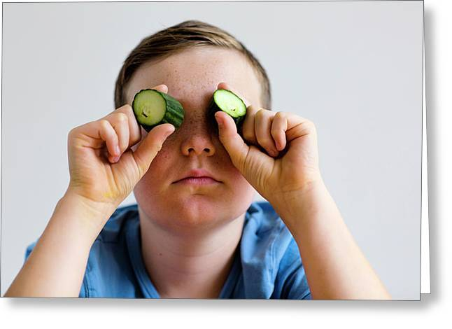 Boy Holding Cucumber Over Eyes Greeting Card by Gombert, Sigrid