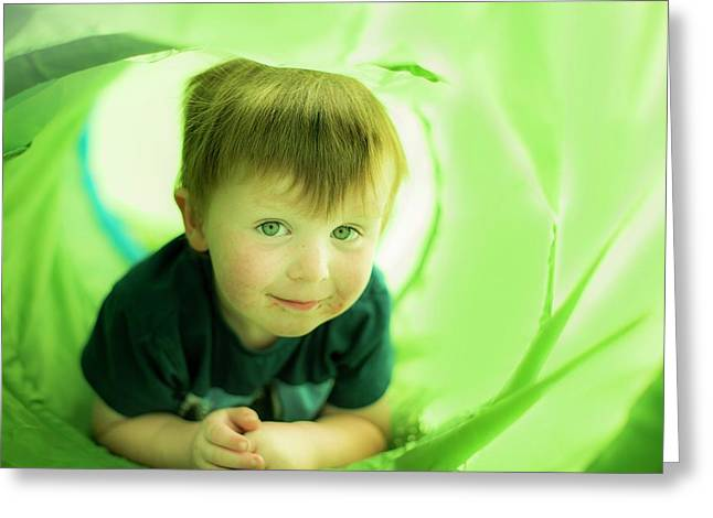 Boy In Green Tunnel Greeting Card