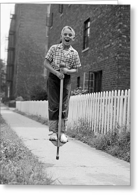 Boy On Pogo Stick, C.1960s Greeting Card by Debrocke/ClassicStock