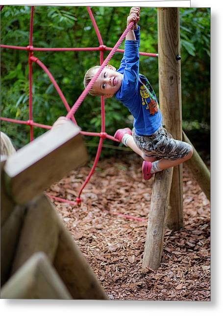 Boy Playing On Climbing Frame Greeting Card