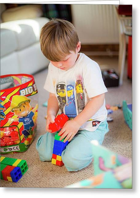 Boy Playing With Plastic Bricks Greeting Card