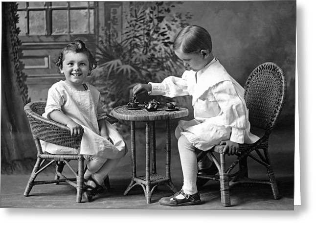 Boy Pours Sister A Cup Of Tea Greeting Card