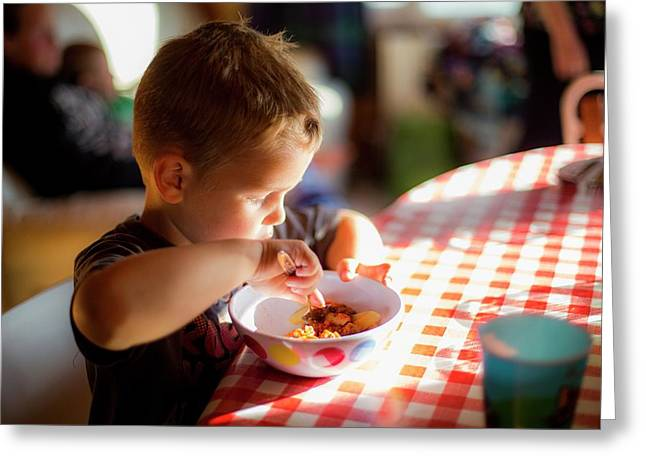 Boy Sitting At Table Eating A Meal Greeting Card