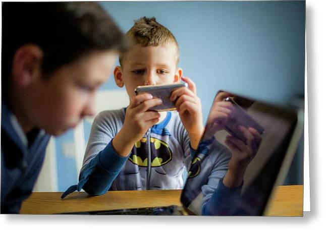 Boy Using Smartphone Greeting Card