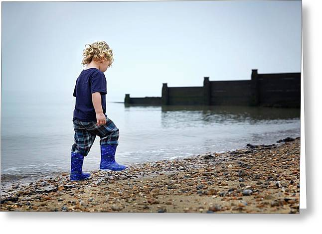 Boy Walking On Beach Greeting Card by Ruth Jenkinson