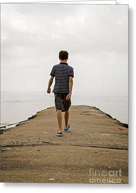 Boy Walking On Concrete Beach Pier Greeting Card by Edward Fielding
