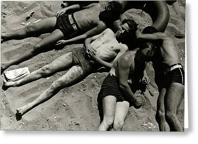 Boys Lying On The Beach At Coney Island In New Greeting Card by Lusha Nelson