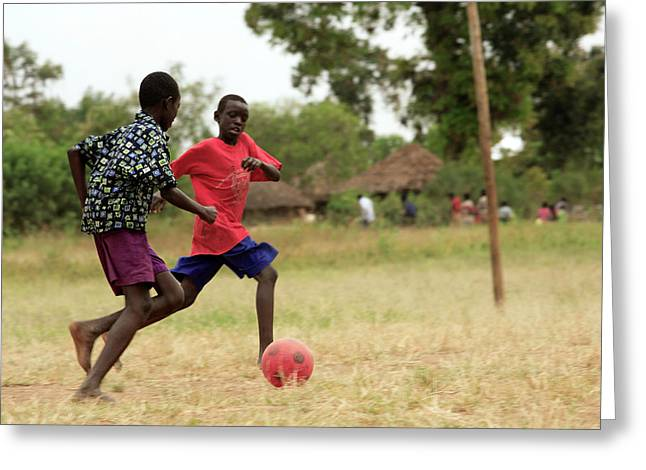 Boys Playing Football Greeting Card by Mauro Fermariello/science Photo Library