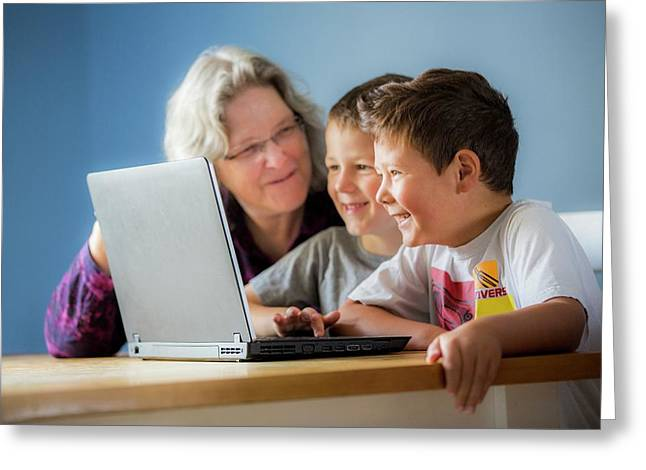 Boys Using Laptop With Grandmother Greeting Card by Samuel Ashfield