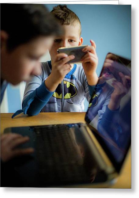 Boys Using Smartphone And Laptop Greeting Card