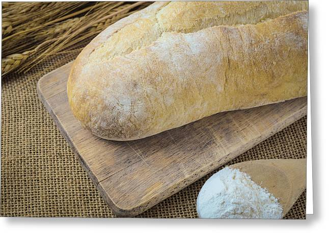 Bread On Bread Board With Wheat And Flour Filled Spoon On Burlap Greeting Card