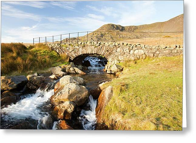 Bridge On The Walna Scar Track Greeting Card by Ashley Cooper