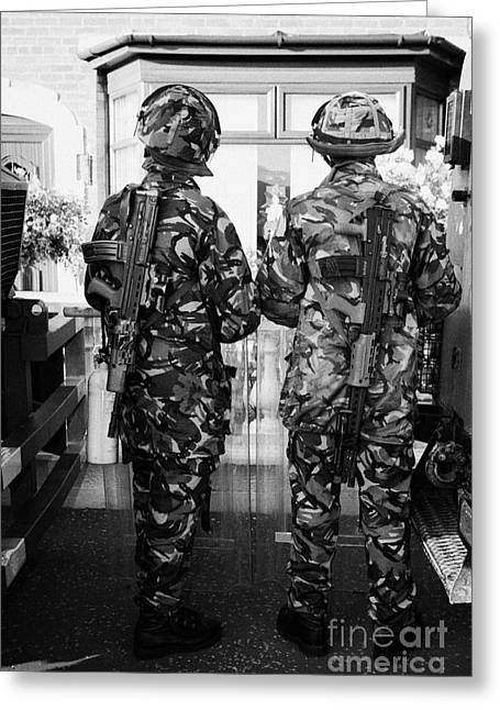 British Army Armed Soldiers In Riot Gear Watch Over House And Garden On Crumlin Road At Ardoyne Shop Greeting Card by Joe Fox