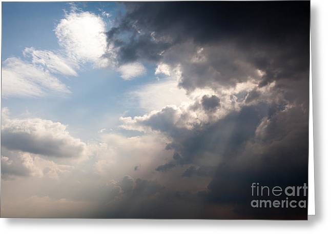Broken Rain Clouds With Blue Sky And Sun Streaming Through Cloud Greeting Card