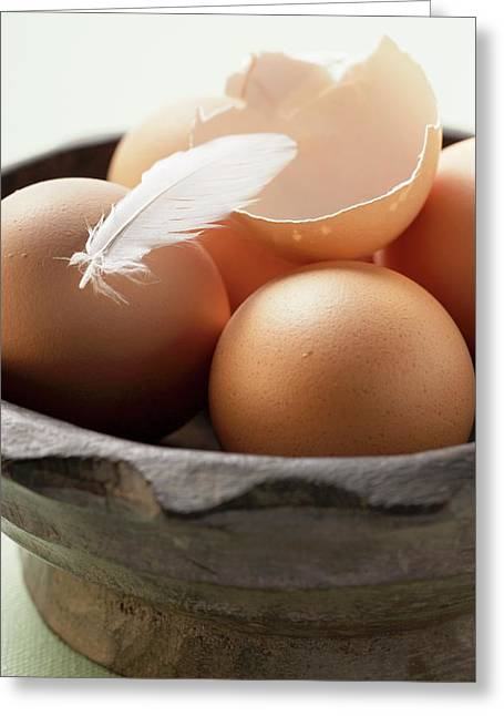 Brown Eggs, Eggshell And Feather In Wooden Bowl Greeting Card