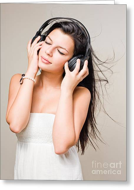 Brunette Immersed In Music Wearing Headphones. Greeting Card by Alstair Thane
