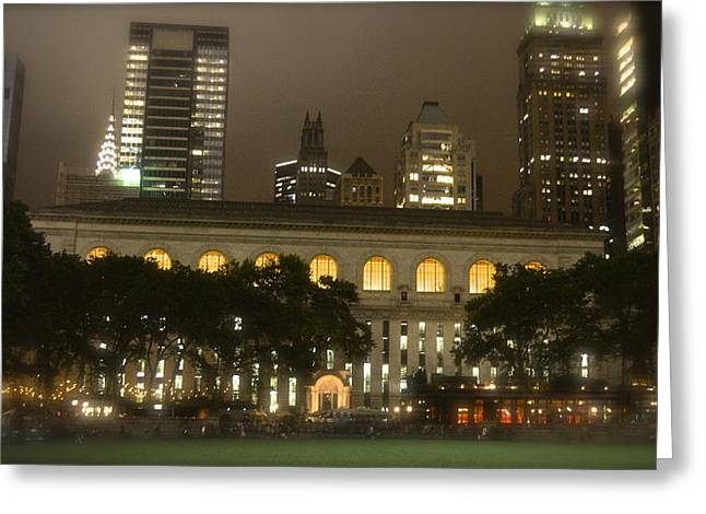 Bryant Park In New York City At Night Greeting Card by Michael Dagostino