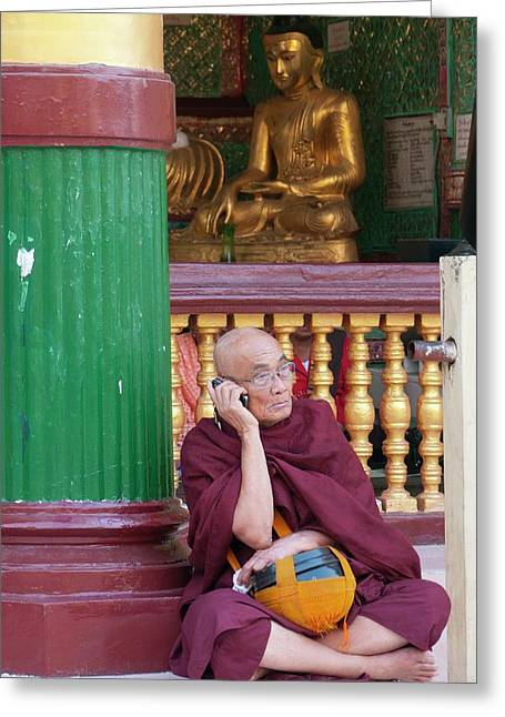 Buddhist Monk On Mobile Phone Greeting Card by Peter Menzel