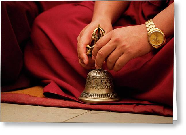 Buddhist Monk Playing Musical Bell Greeting Card by Jaina Mishra