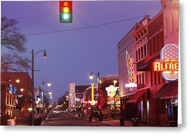 Buildings Along The Street Lit Greeting Card by Panoramic Images