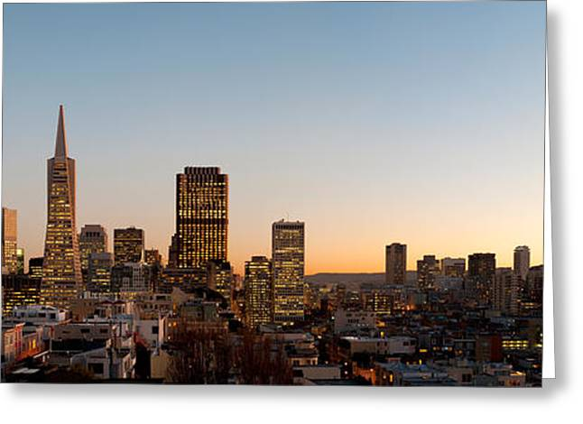 Buildings Lit Up At Dusk, Telegraph Greeting Card by Panoramic Images