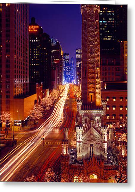 Buildings Lit Up At Night, Water Tower Greeting Card by Panoramic Images