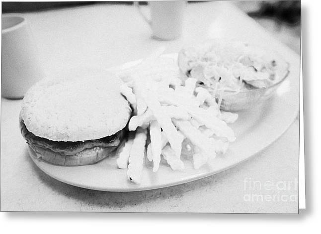 Burger Crinkle Cut Fries And Salad In A Cheap Diner In North America Greeting Card by Joe Fox