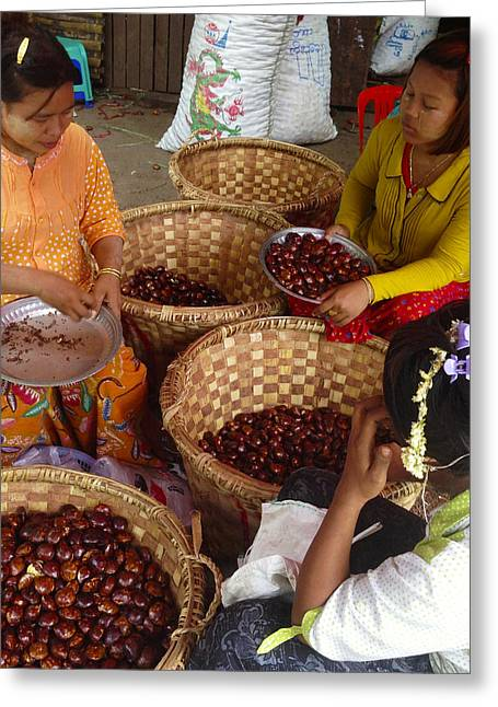 Greeting Card featuring the photograph Burmese Ladies Sorting Water Chestnuts Zay Cho Street Market 29th Street Mandalay Burma by Ralph A  Ledergerber-Photography