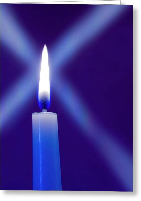 Burning Candle With Star Burst On Blue Greeting Card