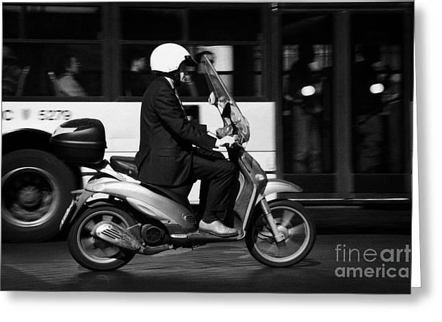 Business Man In Suit And White Helmet On Scooter Commutes Past Bus Full Of Passengers Through Piazza Greeting Card by Joe Fox