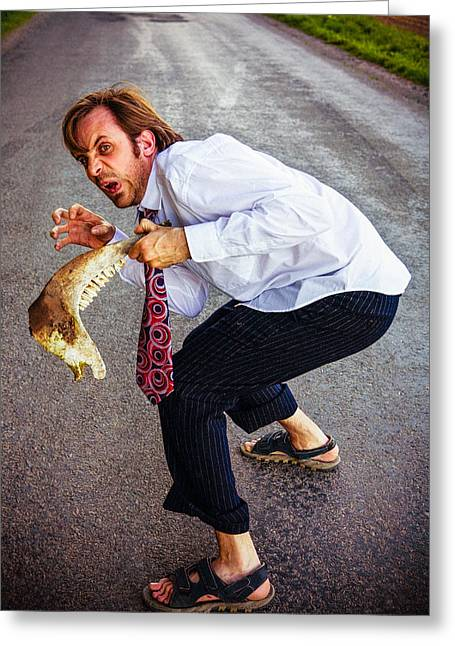 Businessman Holding Animal Jaw Greeting Card by Instants