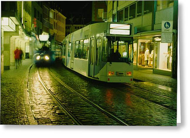 Cable Cars Moving On A Street Greeting Card by Panoramic Images