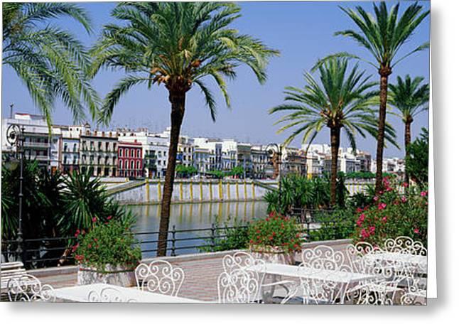 Cafe At The Riverside, Guadalquivir Greeting Card by Panoramic Images