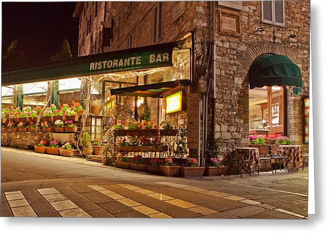Cafe In Assisi At Night Greeting Card by Susan Schmitz