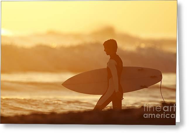 California, San Clemente, Surfer Walking Towards Ocean At Sunset. Editorial Use Only. Greeting Card by MakenaStockMedia