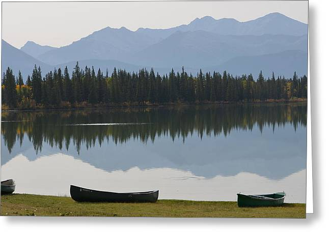 Canoes On Lake Greeting Card by Cheryl Miller