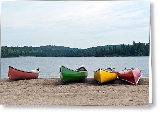 Canoes On The Lake Greeting Card by Marek Poplawski