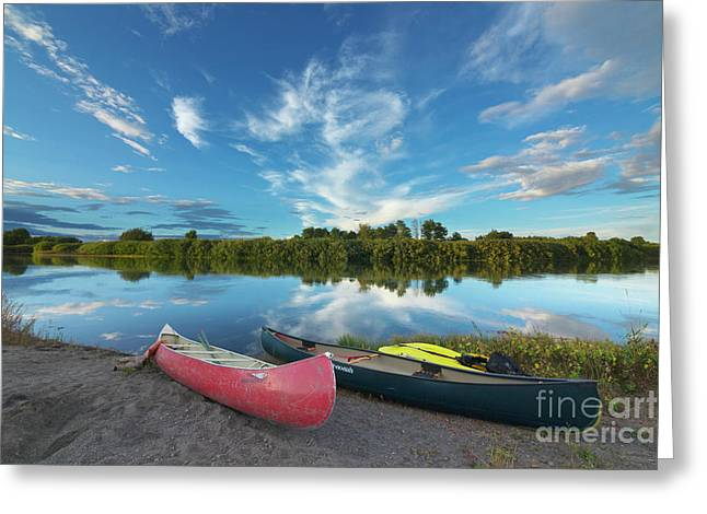 Canoes With Clouds Reflecting  Greeting Card