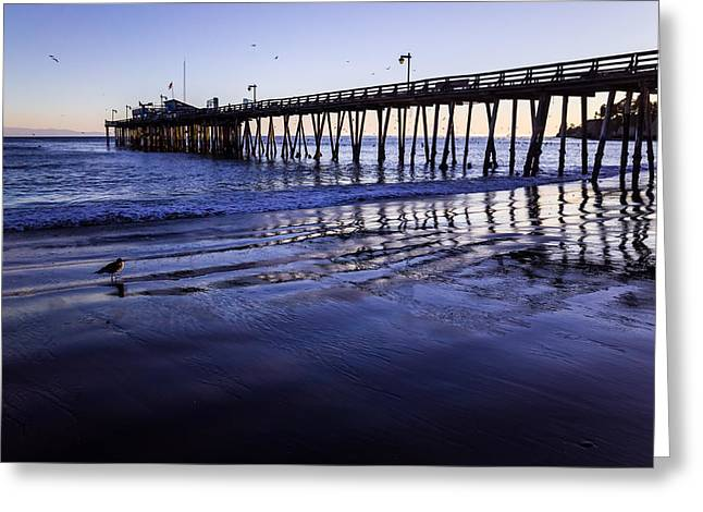 Capitola Wharf Reflections Greeting Card by Priya Ghose