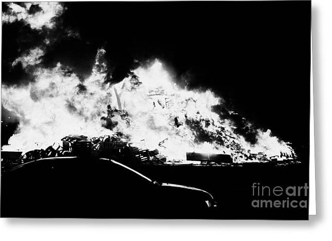 car driving past 11th night bonfire in Monkstown Greeting Card by Joe Fox