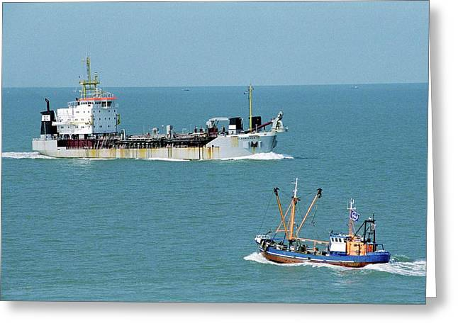 Cargo Ship And Fishing Boat Greeting Card by Christophe Vander Eecken/reporters/science Photo Library