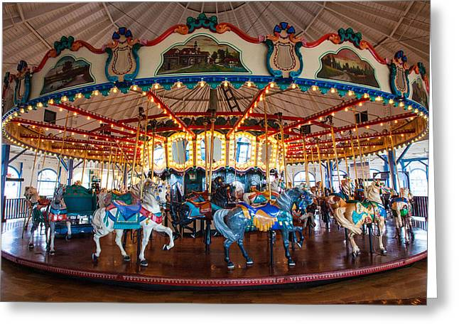 Greeting Card featuring the photograph Carousel Ride by Jerry Cowart