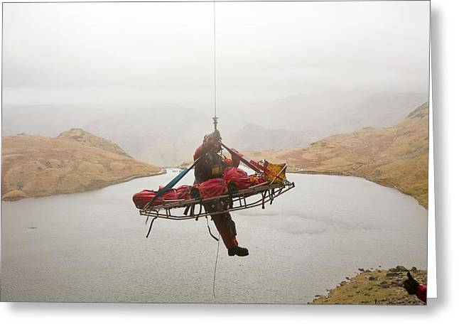 Casualty Winched Into Sea King Helicopter Greeting Card by Ashley Cooper