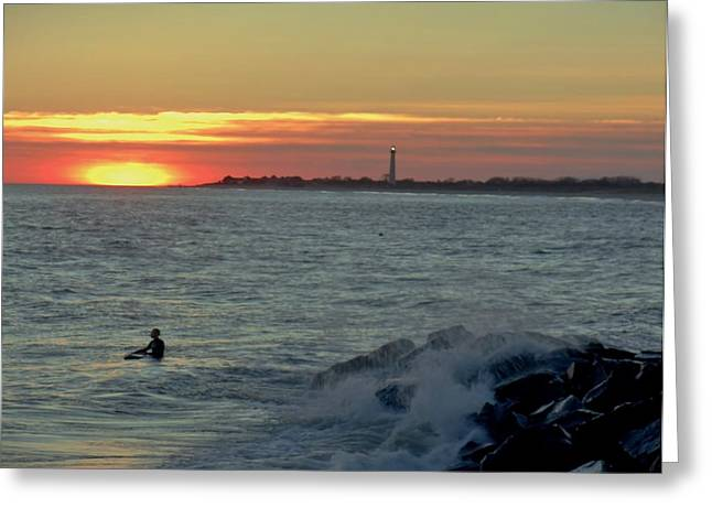 Greeting Card featuring the photograph Catching A Wave At Sunset by Ed Sweeney