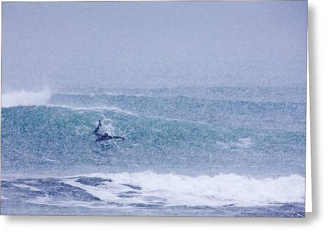 Catching A Wave In A Blizzard Greeting Card by Tim Grams