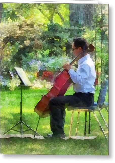Cellist In The Garden Greeting Card by Susan Savad