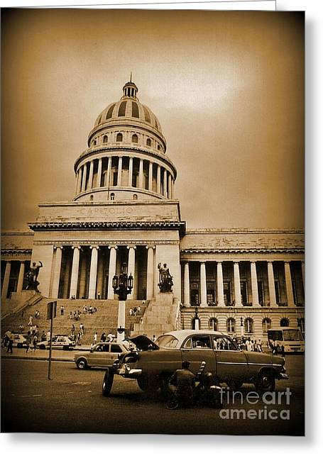 Changing A Tire In Front Of The Capitol Building In Havana Greeting Card by John Malone